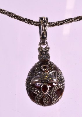 A Silver And Enamel Marcasite Egg Upon A Silver Chain.