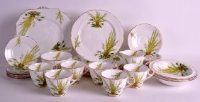 A Royal Stafford Bone China Coffee Service Decorated