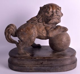 An 18th/19th Century Chinese Pottery Model Of A Dog Of