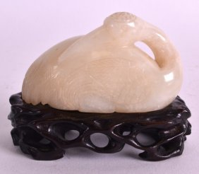A 19th Century Chinese Carved White Jade Model Of A