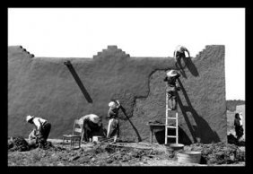 Spanish-american Women Replastering An Adobe House 12x1
