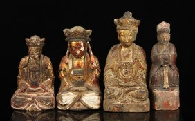 Four Carved Wood Buddha Figures