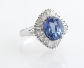 Lady's Platinum Dinner Ring, With An Oval 6.28 Carat