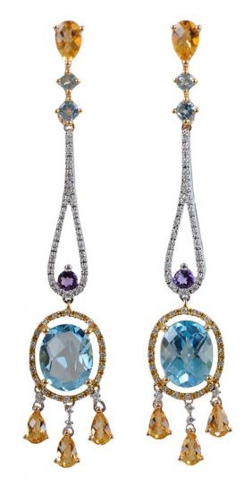 Pair Of 18 Karat Gold And Gemstone