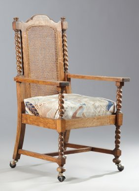Arts And Crafts Carved Oak Cane Back Armchair, C. 1900,