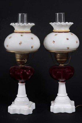 A Pair Of Cranberry Oil Lamps Which Have Been Electr