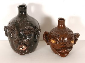 G.T. Cole & Cole Pottery. Pair Of Face Jugs.