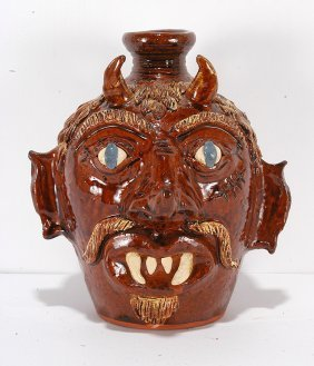 Albert Hodge. Blue Eyed Devil Face Jug.