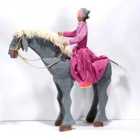 Delbert Buck. Navajo Woman On Horseback.