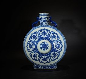 Yongzheng Mark, A Blue And White Floral Moonflask