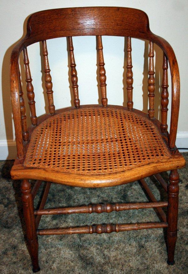 080239 american antique oak and cane captain s chair lot 80239