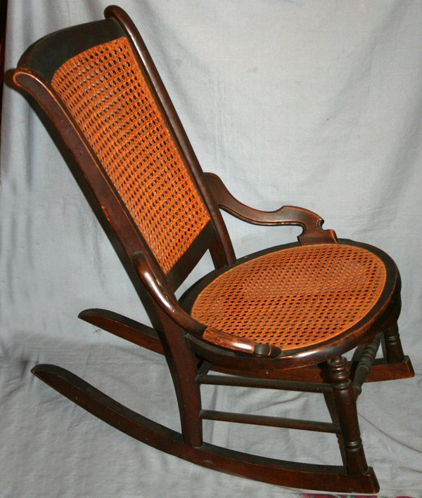 010515 american antique wood and cane rocking chair lot 10515
