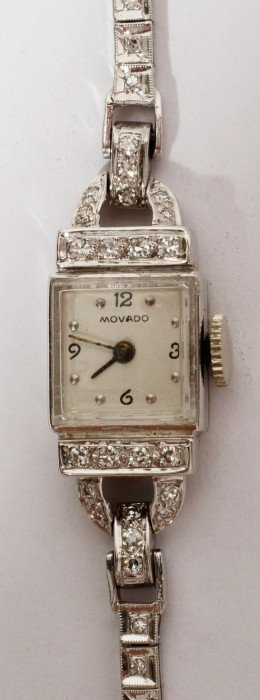 MOVADO W/GOLD LADY'S WRISTWATCH DIAMOND BAND