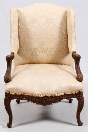 Carved Walnut Open Armchair