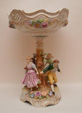 German Porcelain Figural Compote. Condition: Mans Hand
