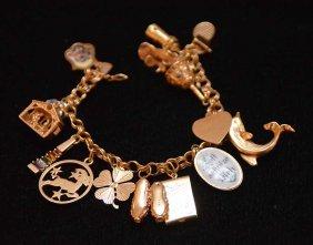 Ladies 14kt Gold Charm Bracelet, 60grams