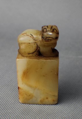 A White Jade Seal With A Lion Top