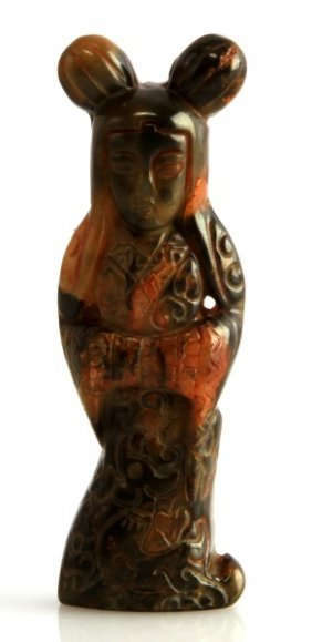 A Chinese Carved Jade Figure Of A Lady