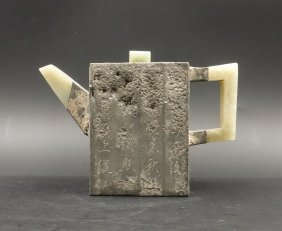 A Chinese Pewter Teapot With Jade Inlaid