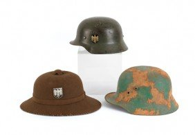 Two German Steel Helmets, Together With A WWII Pi