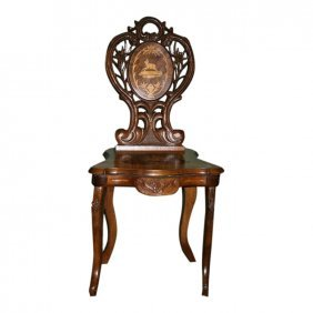 A Black Forest Carved Musical Chair When Sat On