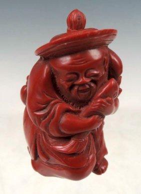 Chinese Cinnabar Figural Snuff Bottle
