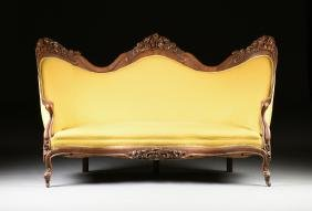 An American Rococo Revival Laminate Rosewood CanapÉ,