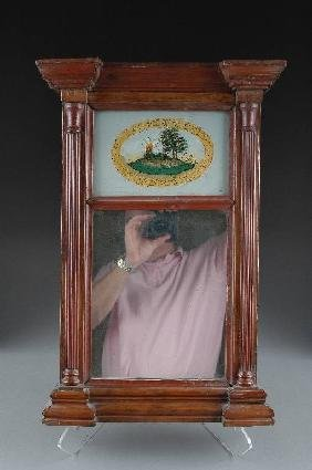 A FEDERAL CARVED MAHOGANY AND REVERSE PAINTED MIRRO