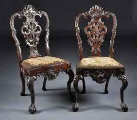 A PAIR OF GEORGE II CARVED MAHOGANY SIDE CHAIRS, MI