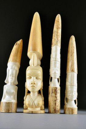 A GROUP OF FOUR AFRICAN IVORY CARVINGS OF NATIVE M