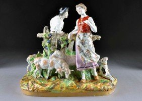 A S�VRES STYLE POLYCHROME PAINTED PORCELAIN FIGURA