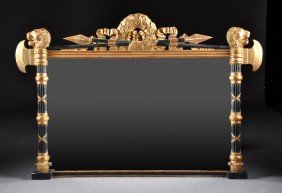 A NEOCLASSICAL STYLE PARCEL GILT AND EBONIZED CARV