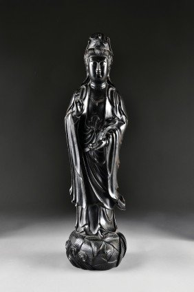 A CHINESE CARVED ZITAN FIGURE OF GUANYIN, 20TH CEN