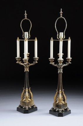 A PAIR OF EMPIRE STYLE GILT METAL FOUR-LIGHT CANDE