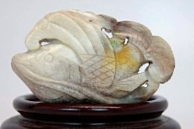 A Small Carved Pale Olive-white Jade Fish Pendant