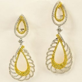 Lady's Round Brilliant Cut Yellow And White Diamond And