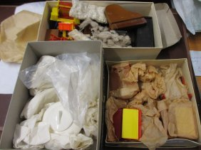 Three Small Boxes Containing A Collection Of Dolls