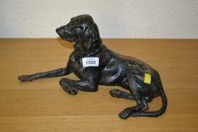 Cast Iron And Painted Figure Of A Reclining Dog