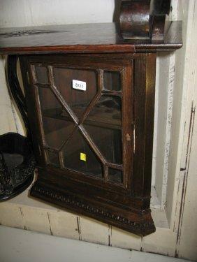 Small Oak Hanging Corner Cabinet With Bar Glazed Panel