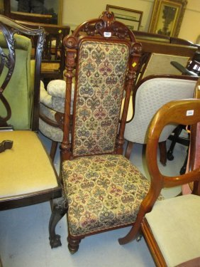 19th Century Walnut Nursing Chair Having Carved And