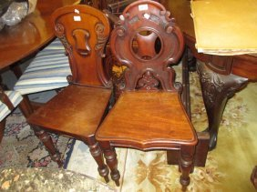 Pair Of 19th Century Mahogany Hall Chairs Having Carved