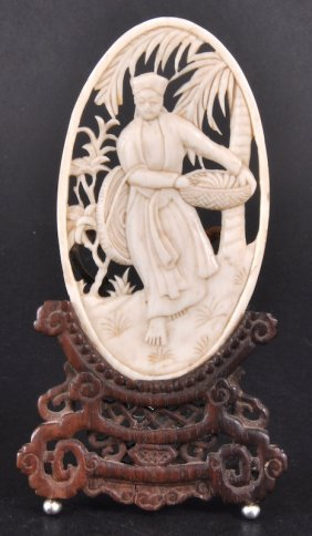 A PIERCED AND CARVED OVAL IVORY TABLET On An Easel