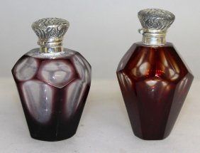 A Pair Of Ruby And Silver Top Scent Bottles.