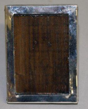 A Small Silver Photograph Frame.