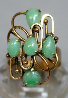 A High Grade Gold And Jade Ring Set With Four Jade