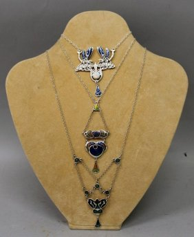 Four Art Deco Silver & Enamel Pendants And Three