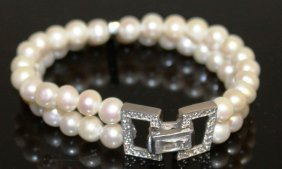 A Two-row Pearl Bracelet Set With Gems.