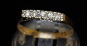 An 18ct Gold And Diamond Ring.