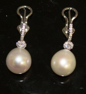 A Pair Of Pearl And Diamond Drop Earrings Set In 18ct