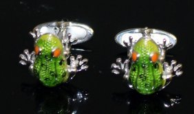 A Pair Of Silver And Enamel Frog Cufflinks.